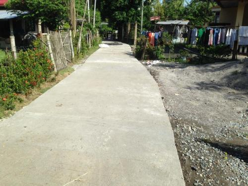 Concreting of Barangay Road, at Barangay Macaguing, Santa Ignacia, Tarlac