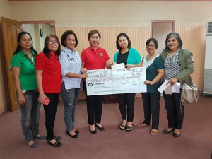 Receiving the check for Senior Citizen Pensioners and Supplemental feeding of Daycare children (2)