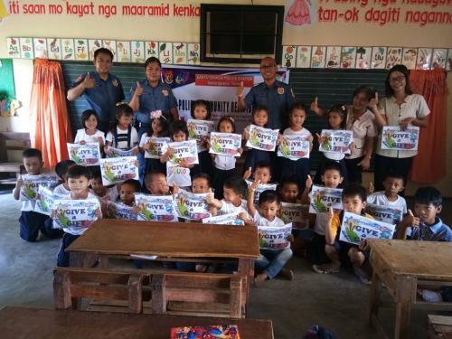 DISTRIBUTION OF SCHOOL SUPPLIES OF GRAGE 1 PUPILS IN CABARUAN ELEMENTARY SCHOOL