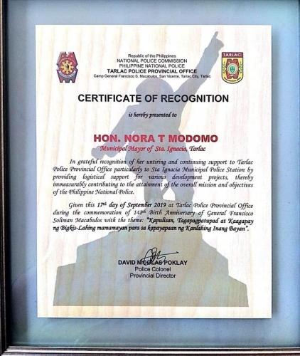 Certificate of Recognition is awarded to Mayor Nora Modomo